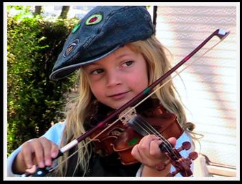 Heavenly Reyna playing violin at 5