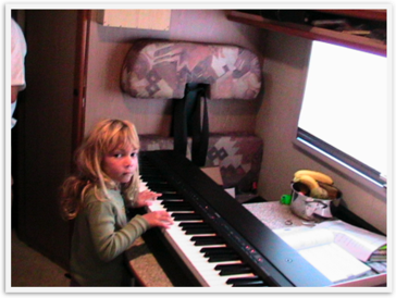 Heavenly Reyna at 5 traveling the world with piano & violin