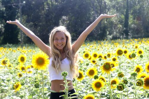Heavenly Reyna in sunflowers on costa brava